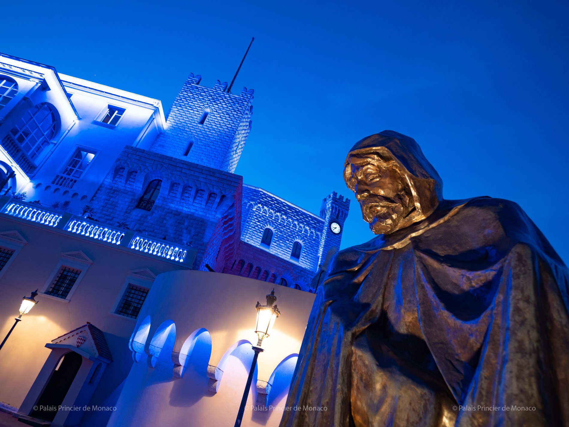 prince's palace statue light it blue covid 19